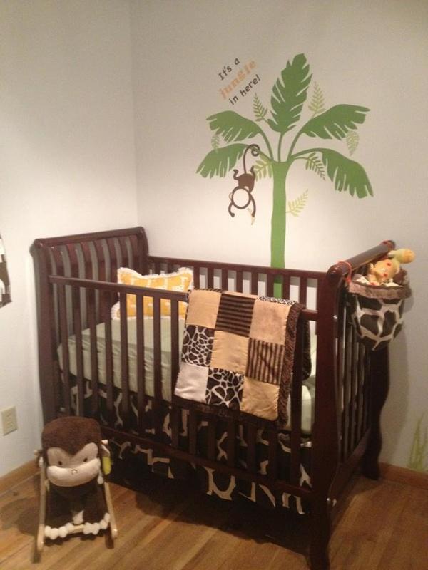 A safari theme nursery with a Fundango tree decal