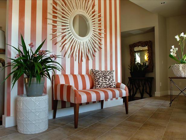 A dynamic entryway that mixes stripes into the mix via HGTV