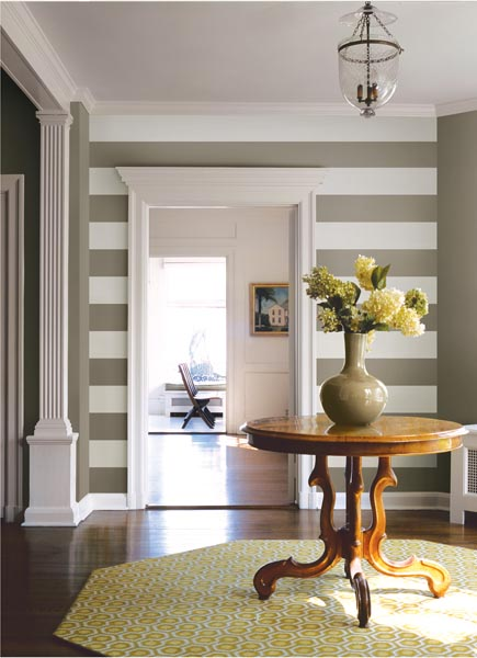 A Stylish foyer with striped walls and fresh flowers