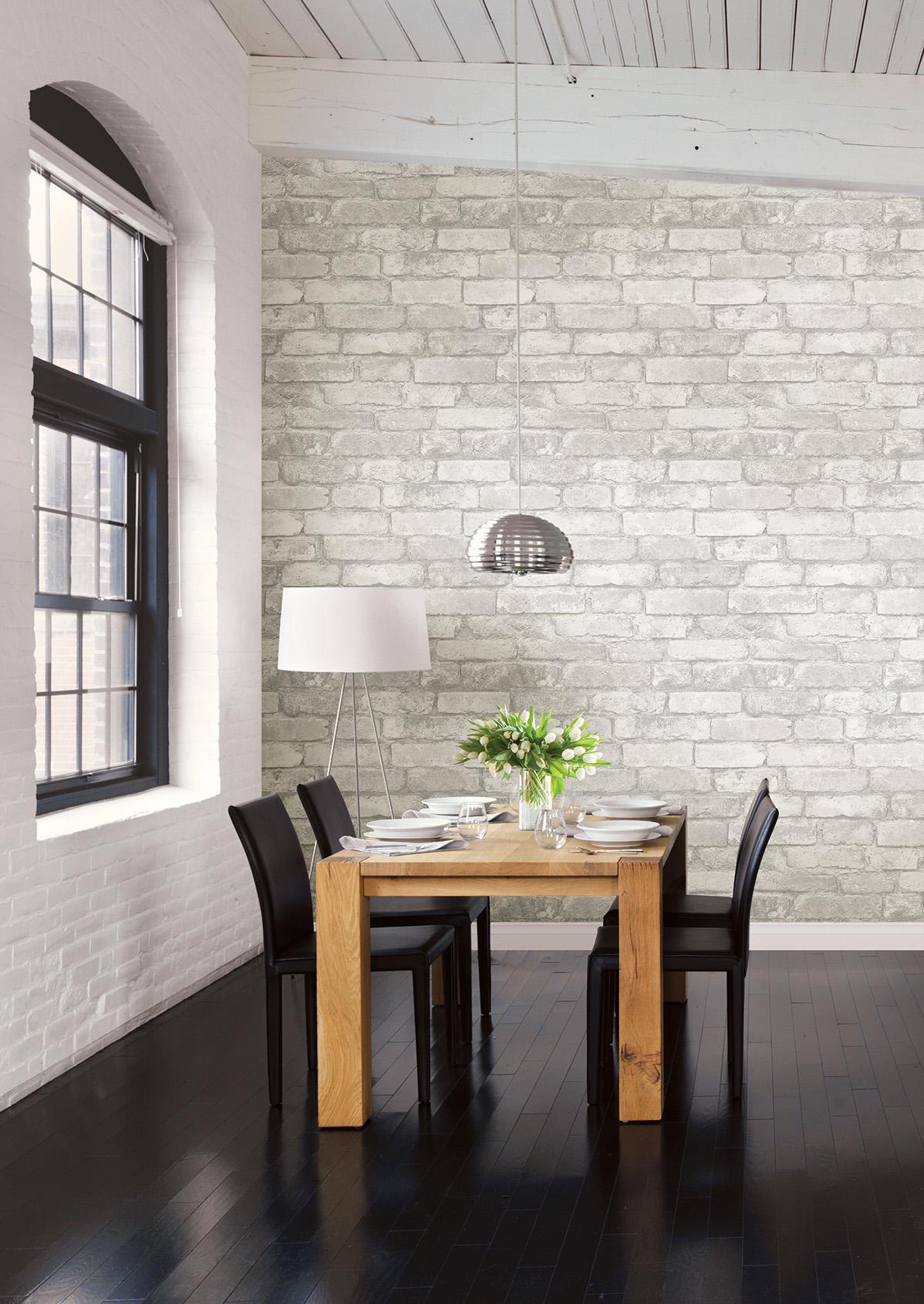 whitewashed brick loft dining room