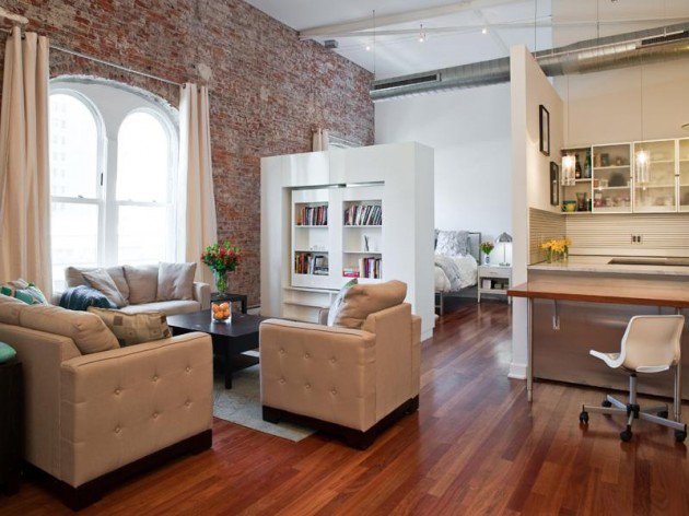 Loft with exposed brick and rotating wall