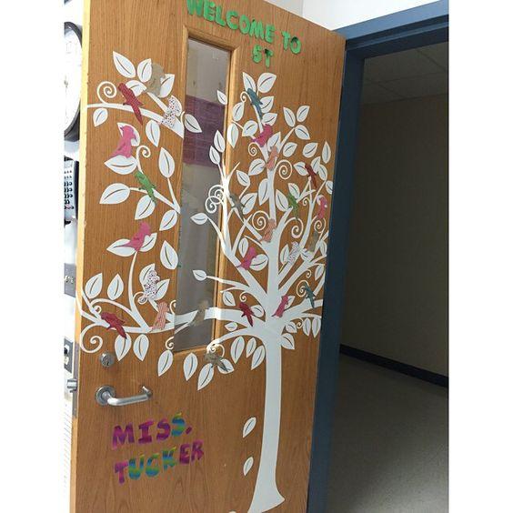 A tree decal decorates a classroom door
