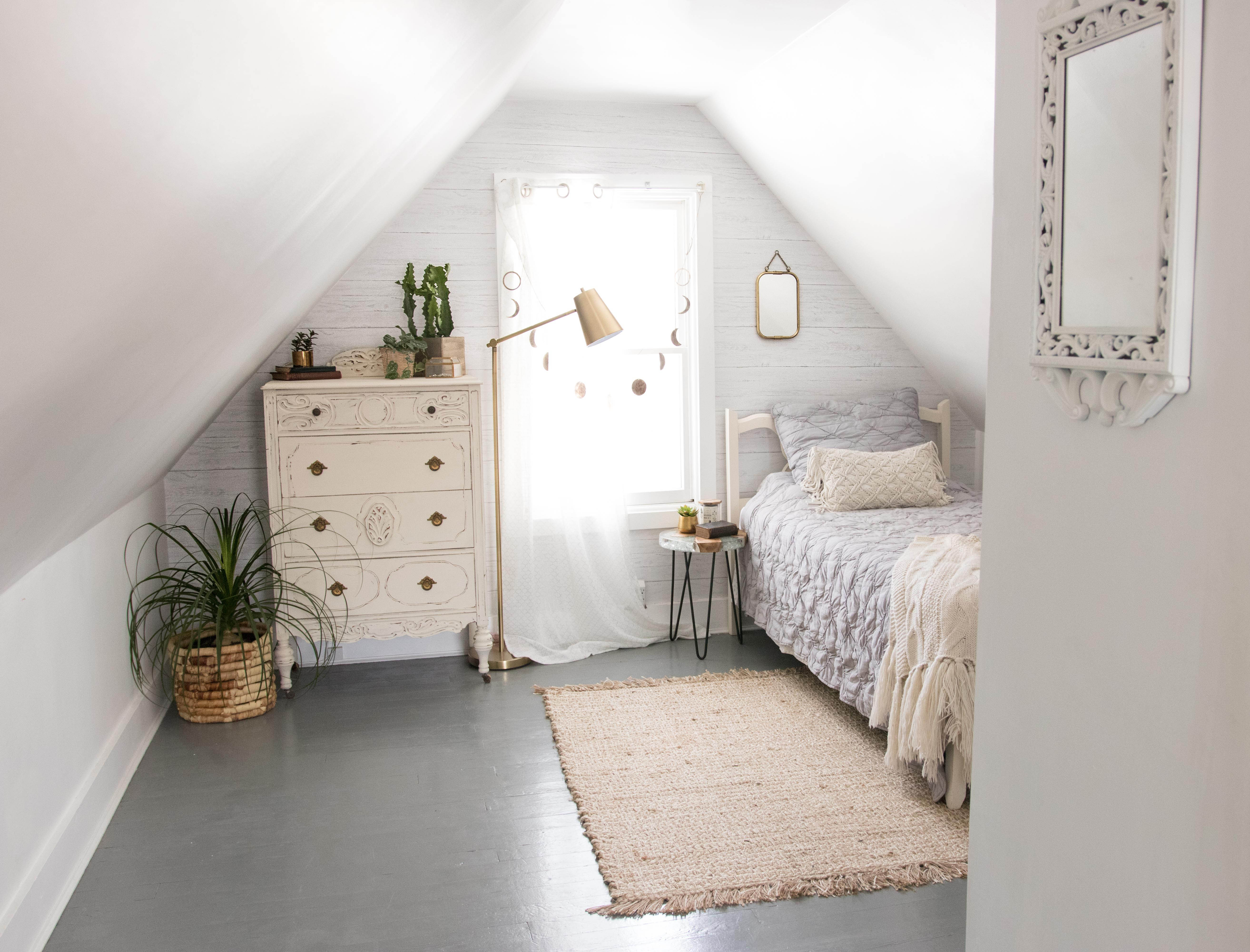 neutral loft a-frame bedroom with shiplap feature wall