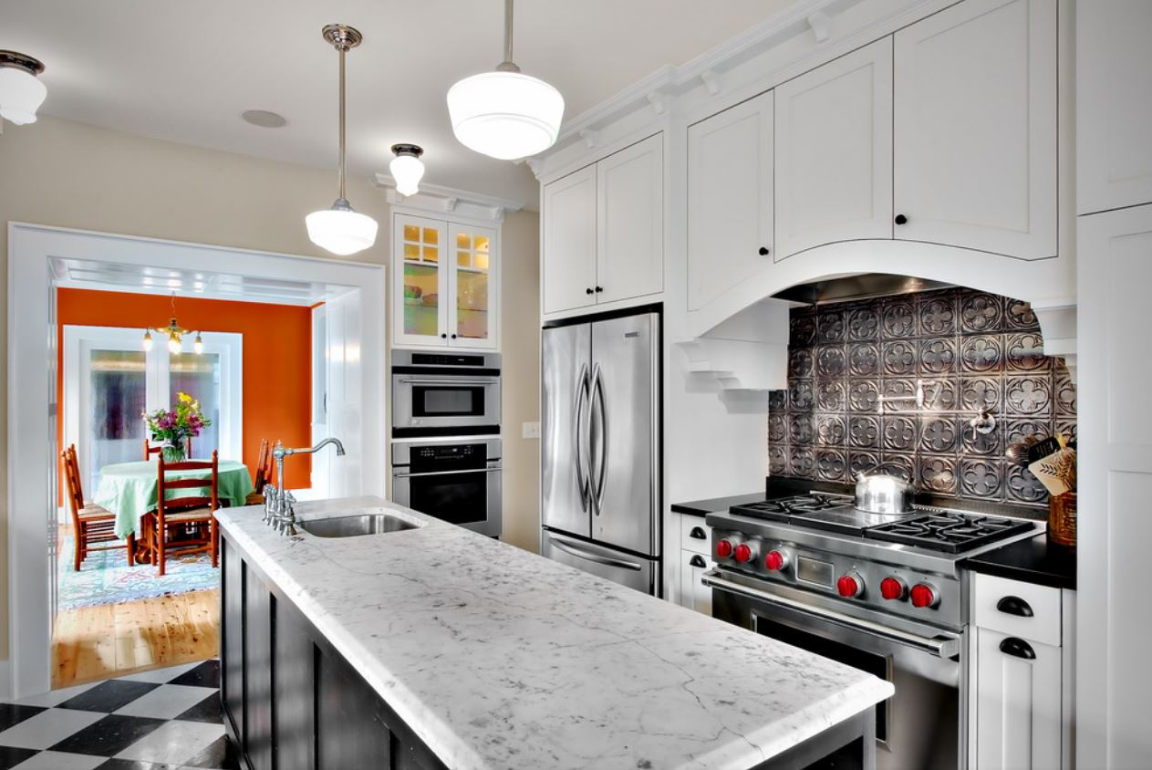 Modern industrial kitchen with silver tin tile backsplash