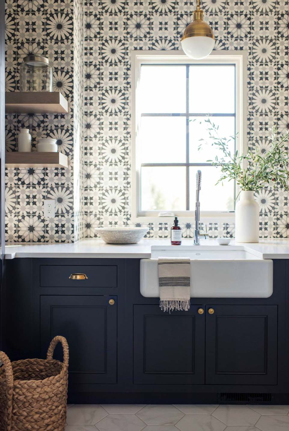 Transitional kitchen with navy cabinets and unique patterned backsplash tile